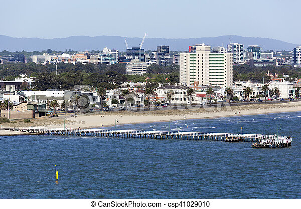 The view of a wooden pier and Melbourne city beach (Victoria).