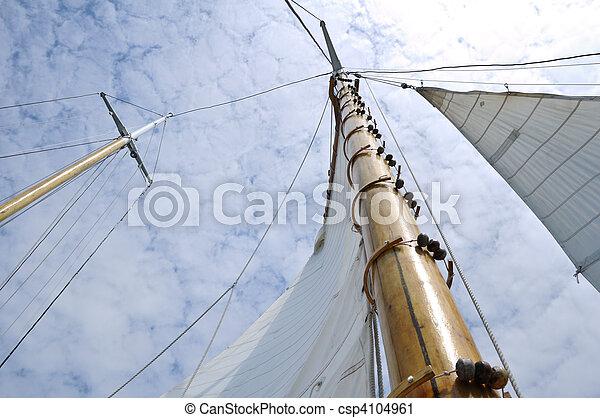 Jib and Wooden Mast of Schooner Sailboat - csp4104961