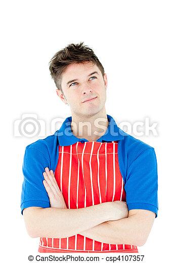 Image de s rieux jeune cuisinier porter tablier pli for Cuisinier bras