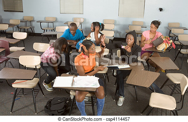 Highschool students messing in class during break - csp4114457
