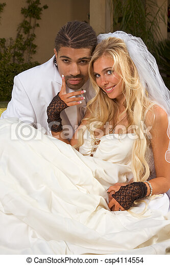 Happy new wed interracial couple in wedding mood - csp4114554