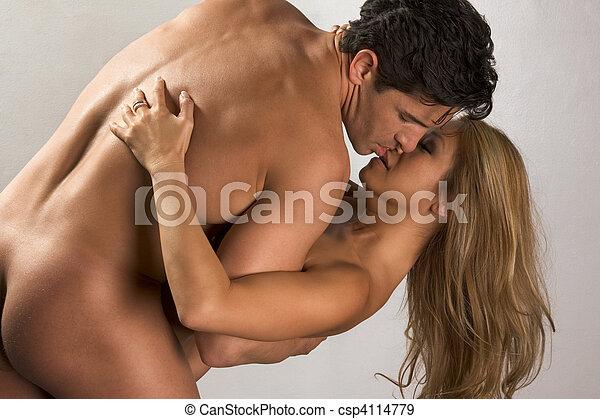 Naked mid aged interracial couple in love kissing - csp4114779