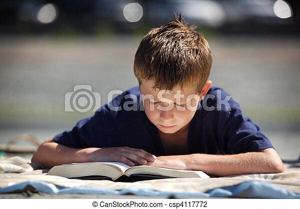 boy reading - csp4117772