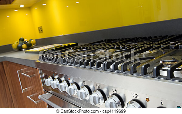 Close Up Shot Across Cooker in Modern Colourful Kitchen - csp4119699