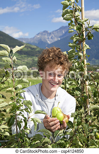 smiling teenager presenting apples