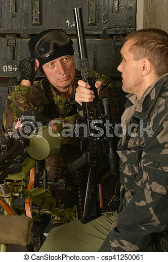 Portrait of armed combat soldiers in ammunition