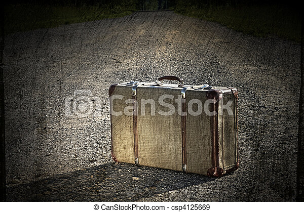Old suitcase left on a dirt road - csp4125669