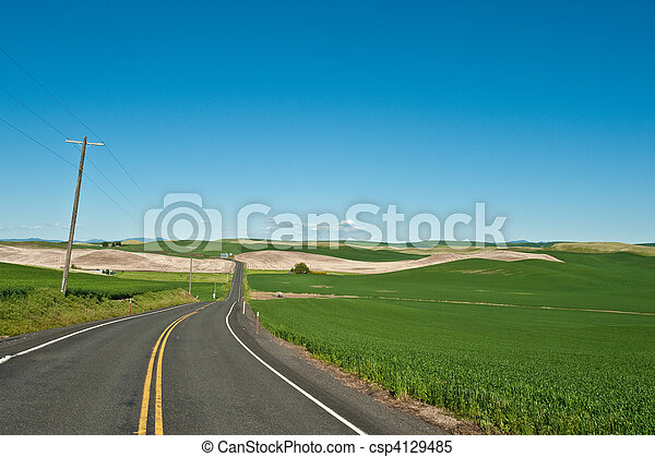 A lone and empty country road - csp4129485