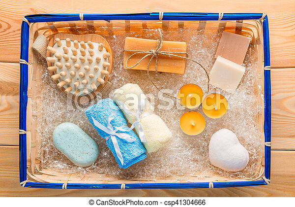 set for spa with several kinds of soap on the wooden floor