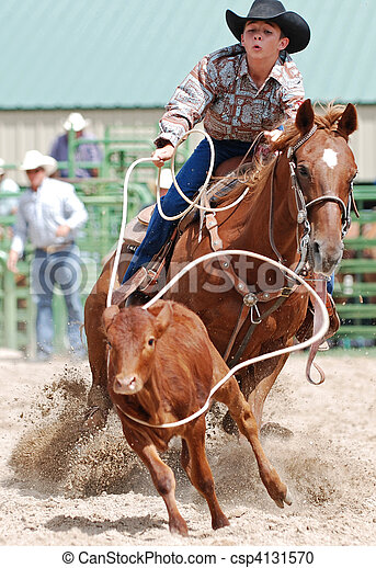 Young man roping a calf in a rodeo competition.