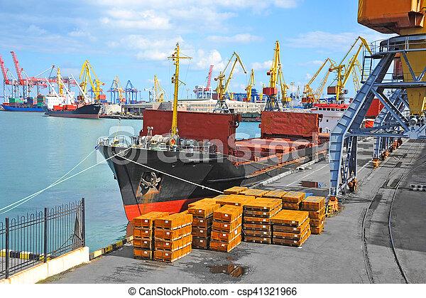 Bulk cargo ship under port crane bridge, Odessa, Ukraine