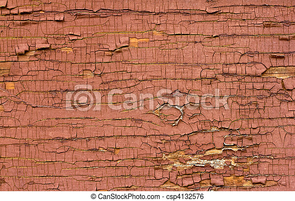 Old red oil paint peeling away from wood surface.