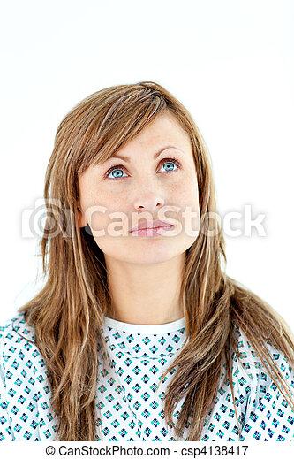 Morbid female patient looking upwards wearing patient gown - csp4138417