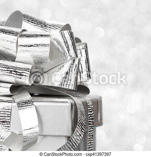 Decorative holiday Gift box and ribbon on bright shiny background