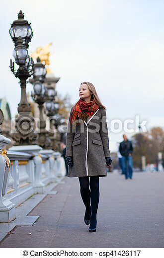 Beautiful girl walking in Paris - csp41426117