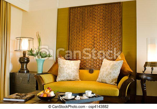 Contemporary living area resort hotel suite room - csp4143882