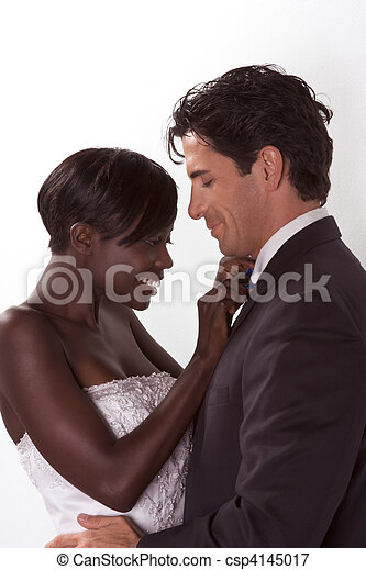 happy new wed interracial couple in wedding mood - csp4145017