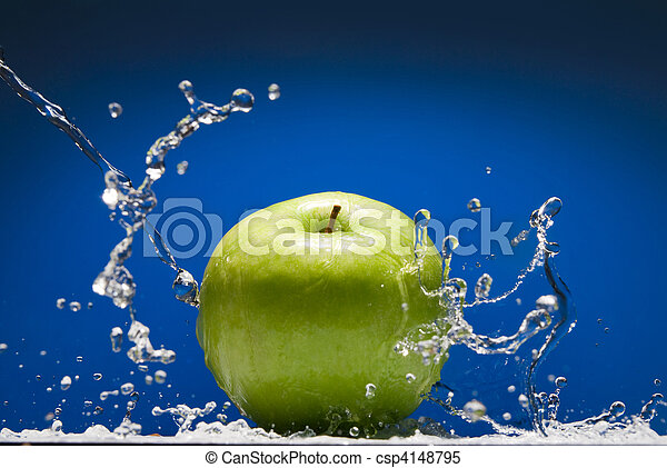 Green apple with water splash on blue background - csp4148795