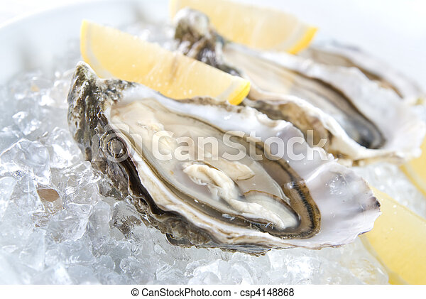 raw oysters with lemon and ice - csp4148868