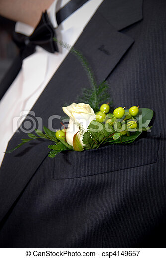 wedding buttonhole with rose on mans suite - csp4149657