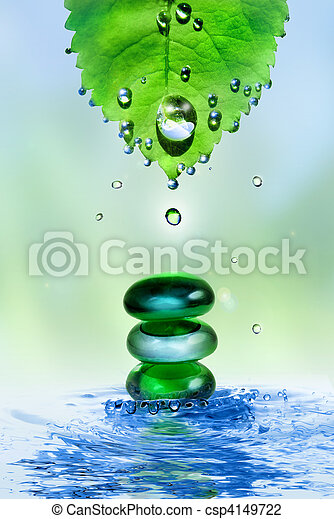 balancing spa shiny stones in water splash with leaf and drops - csp4149722