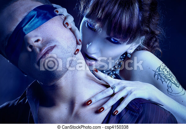 woman vampire bites a blindfolded man - csp4150338