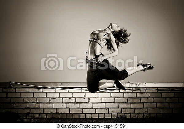 black and white photo of girl jumping on the roof - csp4151591