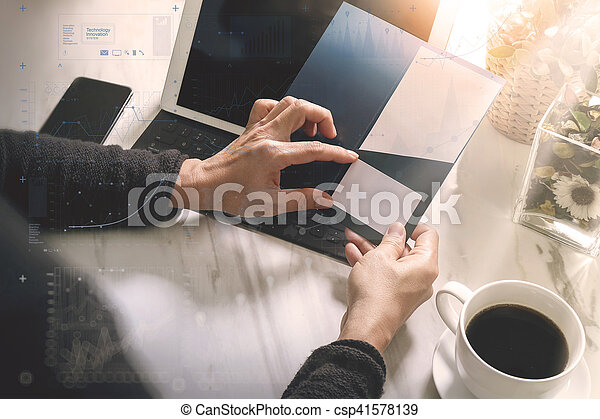 Businessperson Hands holding New Gift Card or Credit card,digital tablet computer dock keyboard,smart phone on marble desk,filter effect,icons screen