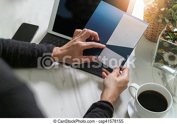 Businessperson Hands holding New Gift Card or Credit card,digital tablet computer dock keyboard,smart phone on marble desk,filter effect