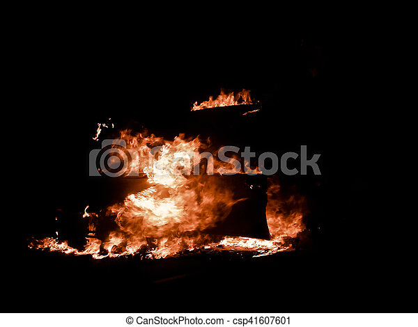 Car on fire in the street with flames blazing, Pune, Maharashtra, India