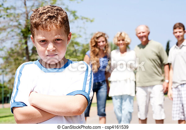 Extended family posing, young child on focus - csp4161539