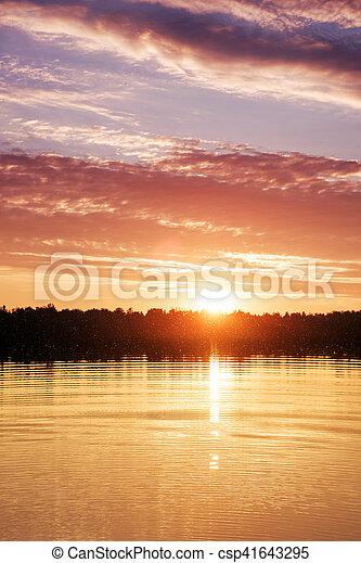 Beautiful sunset over the lake - csp41643295