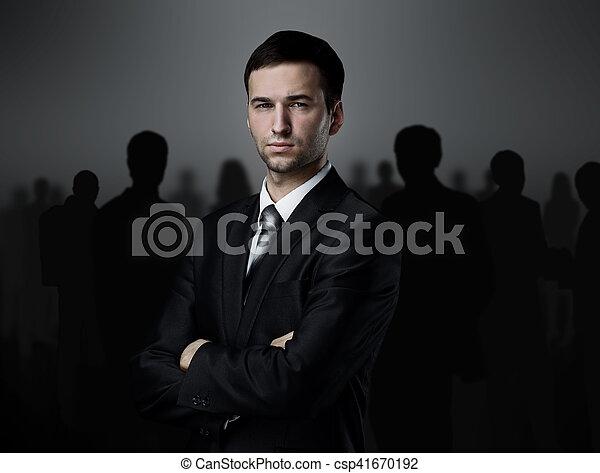 business team standing over a dark background - csp41670192