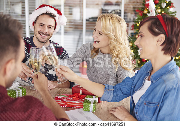 Young people toasting during Christmas Party