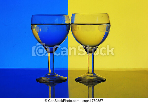 glass of water on blue yellow background - csp41760857