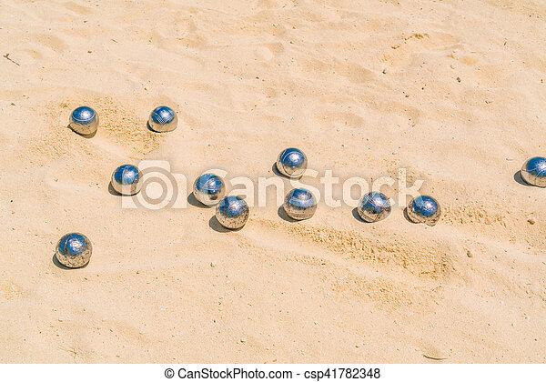 Bocce balls on white sandy beach . - csp41782348