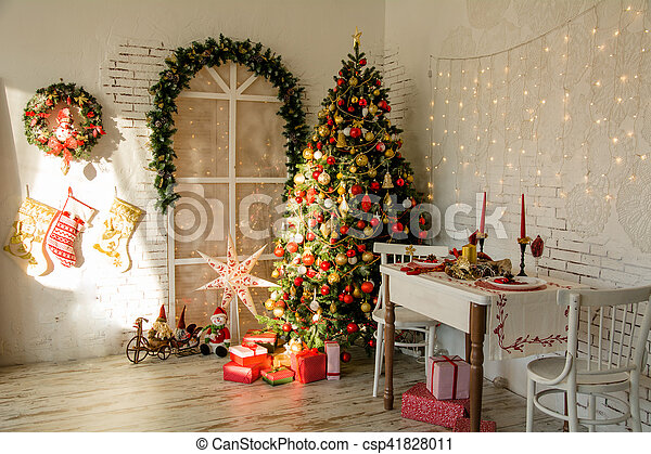Interior room with Christmas fir and the banquet table in the style of a country house