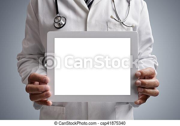Doctor showing blank digital tablet screen - csp41875340
