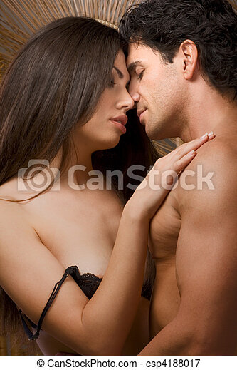 Young Man and undressing woman in love are kissing - csp4188017