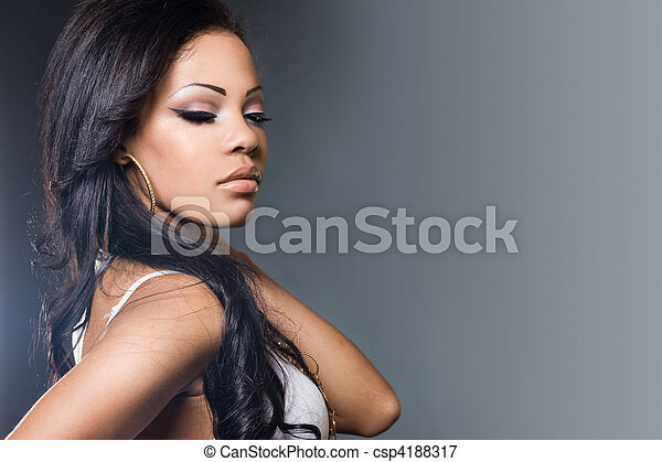 Sexy fashionable mulatto woman in a t-shirt - csp4188317
