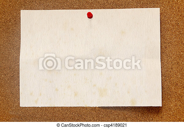 Old stained paper on a cork noticeboard. - csp4189021