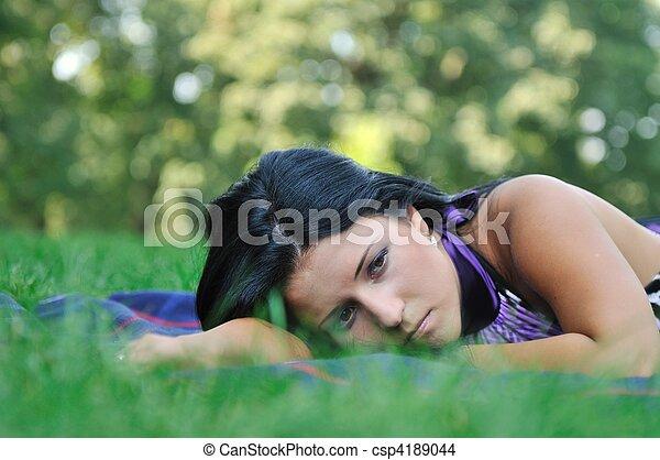 stock foto von sehr traurige junger frau gras. Black Bedroom Furniture Sets. Home Design Ideas