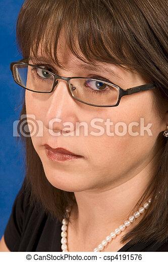 Beautiful woman in her 30s wearing eyeglasses - csp4191576