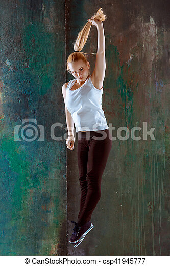 The women jumping and dancing fitness or hip hop choreography in green studio background