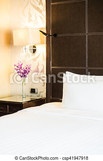 White pillow on bed decoration in hotel luxury bedroom interior