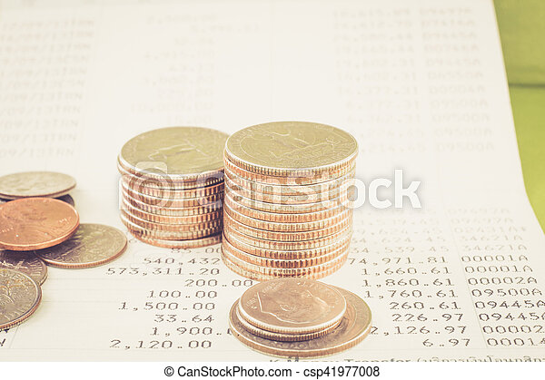 Coin stack on account book bank with retro color effect