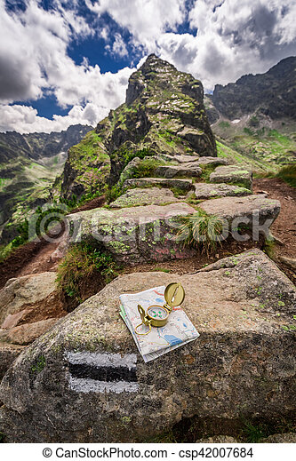 Orientation in mountains in summer with map and compass, Poland