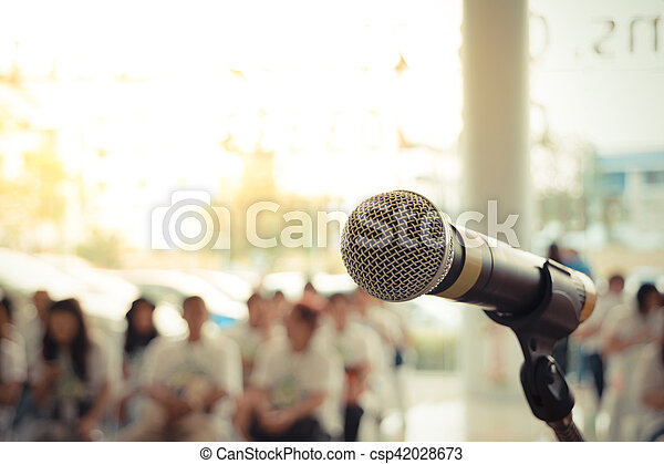 Microphone in seminar event defocus on person background , process in vintage style