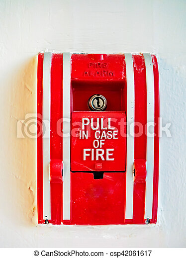 Red emergency fire alarm pulling switch on white wall