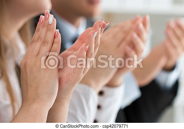 Close up view of business seminar listeners clapping hands. Professional education, business meeting, presentation or coaching concept